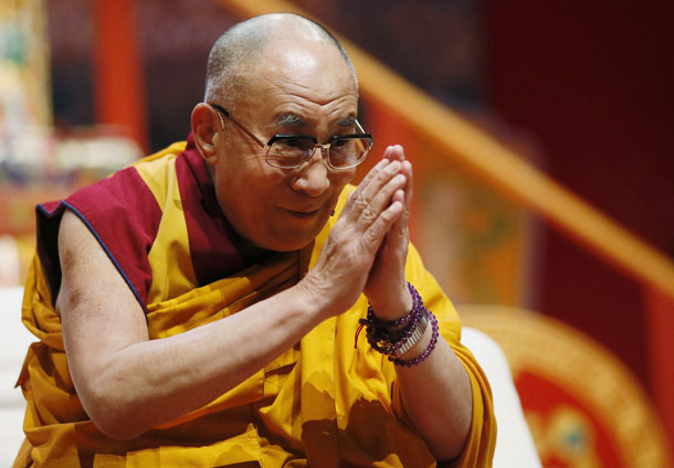 Tibet's exiled spiritual leader the Dalai Lama greets the audience before his second speech during the European Tibetan Buddhist Conference in Fribourg