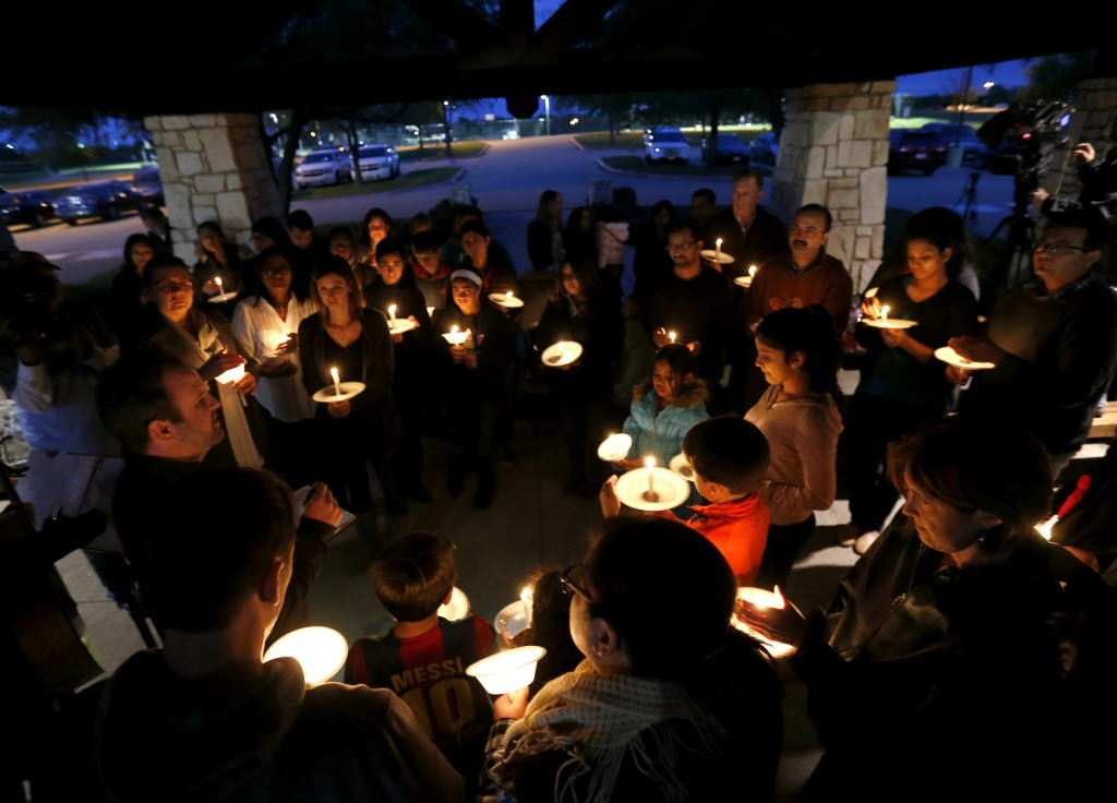 People gather during a Prayer Vigil organized by Frisco Moms Care for the Christine Woo family at Warren Sports Complex in Frisco, Texas, Friday, April 1, 2016. (Jae S. Lee/The Dallas Morning News)